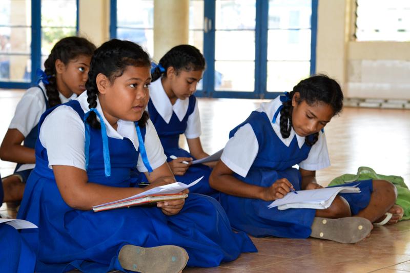 Students at Mailefihi Siu'ilikutapu College listening to 'Apai give instructions.