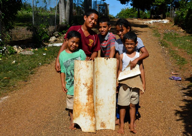 "Tongan kids who created makeshift plastic ""sleds."""