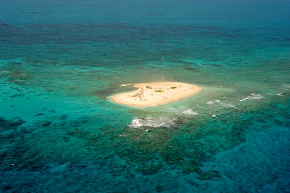 Southeast Cay, a sand spit located on the reef rim of Hogsty Reef, Bahamas