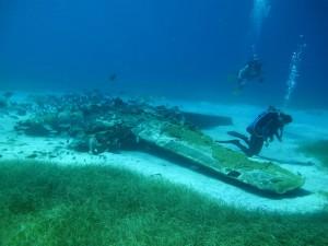 Sand 'halo' around the submerged plane.