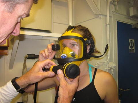 Phil Renaud helps Aurora Alifano, from Island Conservation, get a proper fit with her full-face mask.