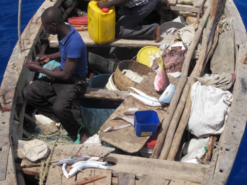 Fishers from Haiti will spend their time fishing and sleeping on a small boat.