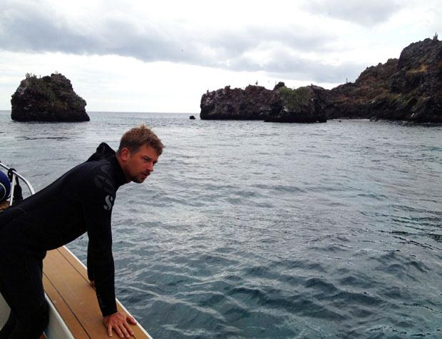 Brian Beck checks for surfacing divers