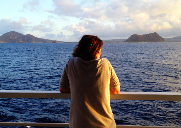 Iliana Burns watches the sun set over Isabela Island