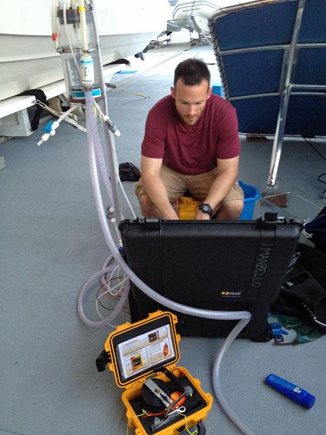 Derek Manzello checks carbon dioxide (CO2) levels in a seawater sample