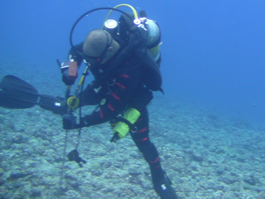 Nick Cautin, Dive Safety Officer, hammers in a stake to mark the Legacy site.