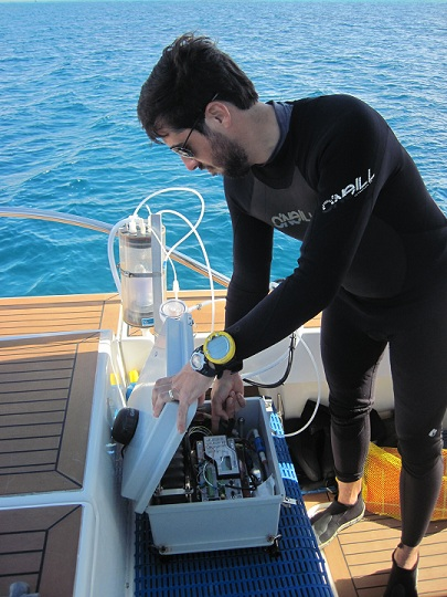 Dr. Ian Enochs prepares his equipment to measure the water's chemistry at each dive site.