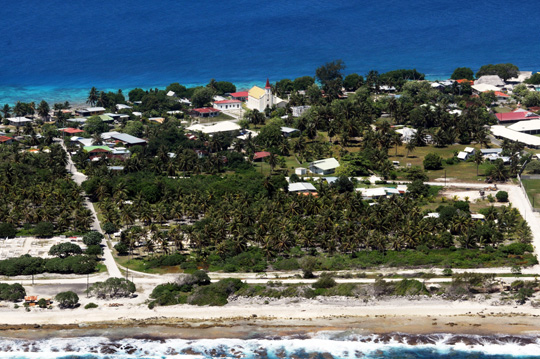 Aerial view of one of the two main villages on Rangiroa, Tiputu