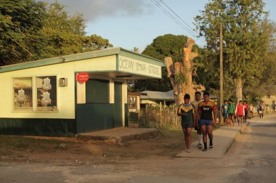 Rugby players make their way home after practice in Vava'u, Tonga.