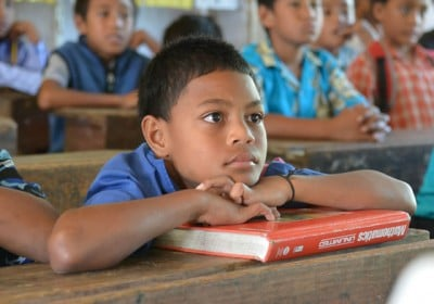 Education Research: Tonga students listened intently to the new information being provided during the coral reef seminar.