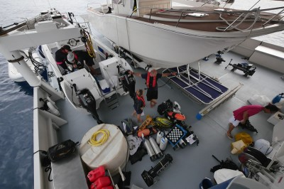 Catlin Seaview Survey team preparing their gear on the deck of the Golden Shadow.