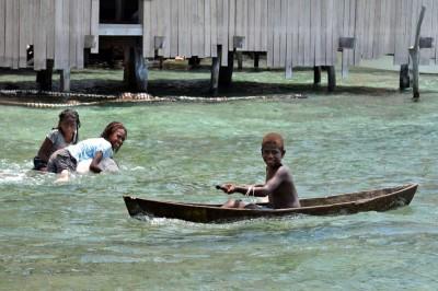 Kia Village Children Play in the Ocean
