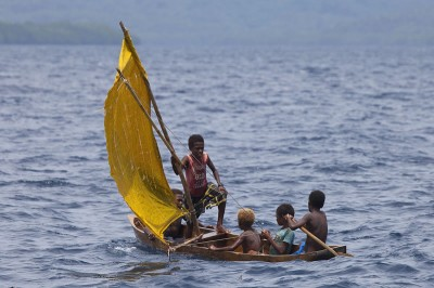 Kia Village traditional dugout canoe with sails.