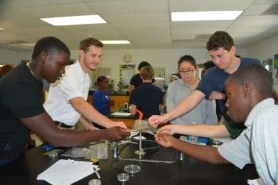 B.A.M. year 2 participants sterilizing their tweezers and scissors for the activity.