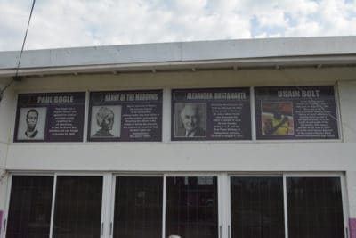 The portraits of the national heroes of Jamaica posted at the front of the school.