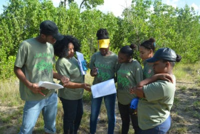 B.A.M. and J.A.M.I.N. – Image 1 - Students from William Knibb High School use scientific tools to measure various non-living factors in their mangrove quadrats.