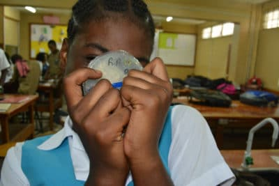 Mangrove Disease - student showing of petri plate