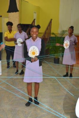 B.A.M. and J.A.M.I.N. –Students from St. Hilda High School form a food web as part of aJ.A.M.I.N. activity.