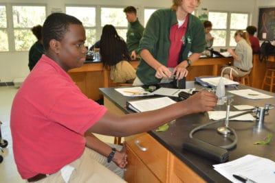 Mangrove Disease - student sterilizing tweezer